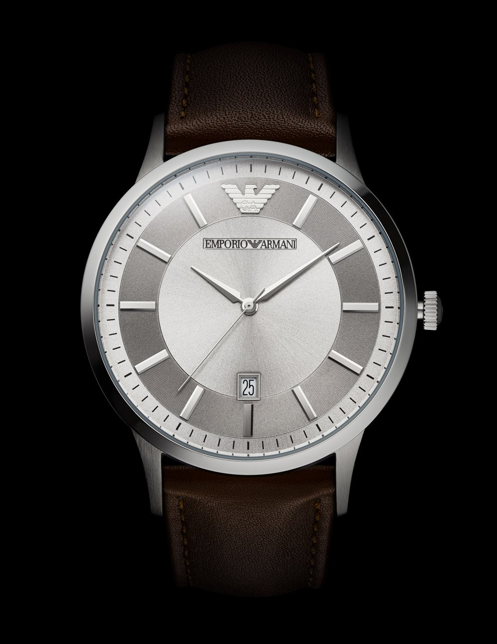 A silver Emporio Armani watch can be seen against a dark background. Demonstrating photographing glossy surface in watch photography