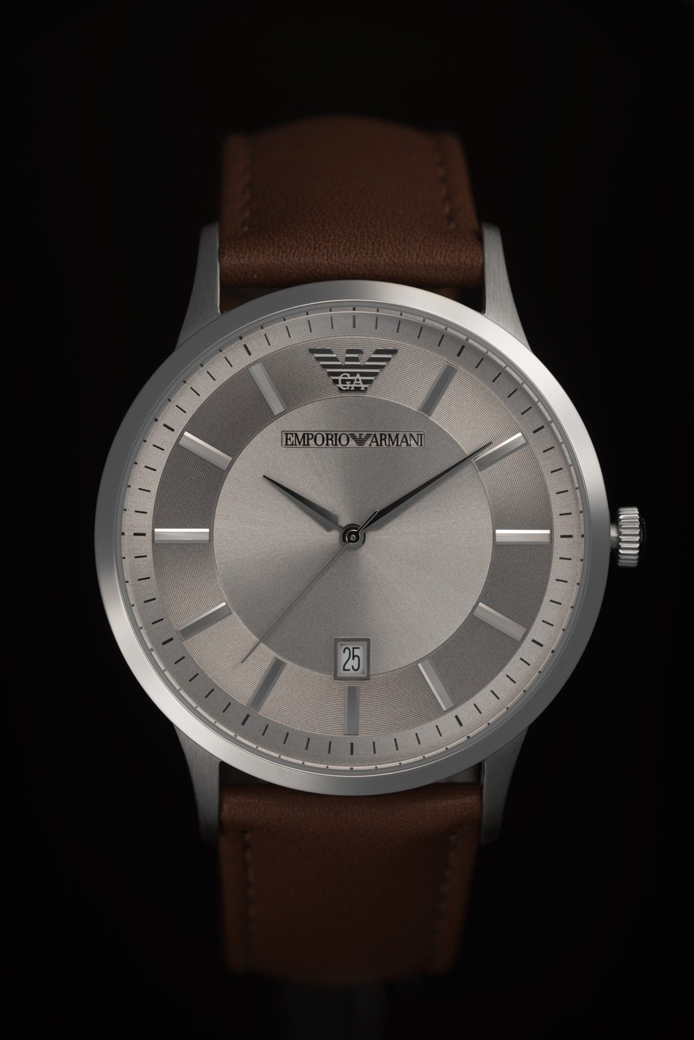 An Emporio Armani watch against a dark background. The watch appears matt and not glossy, a key watch photography tip