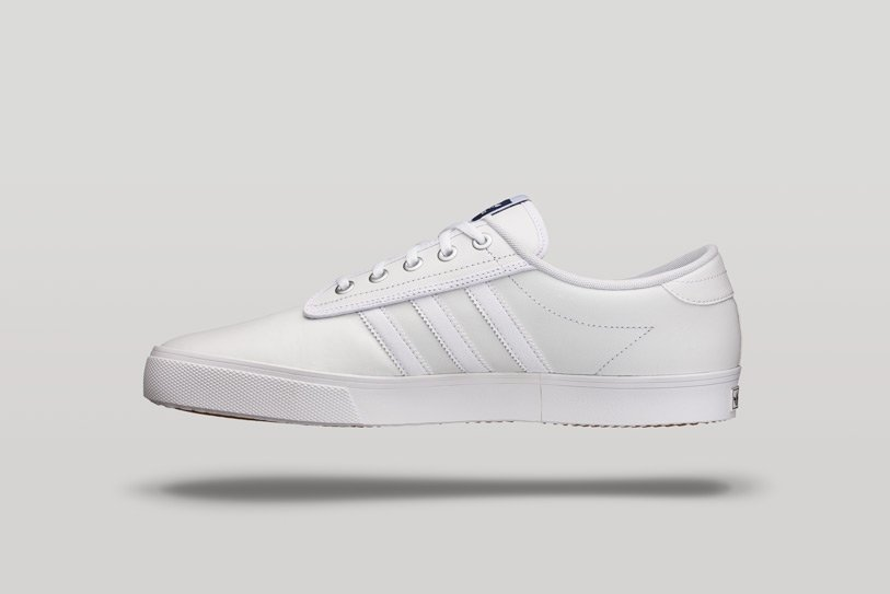 white adidas shoe on a grey background with shadow, photographed by product photographer square mountain